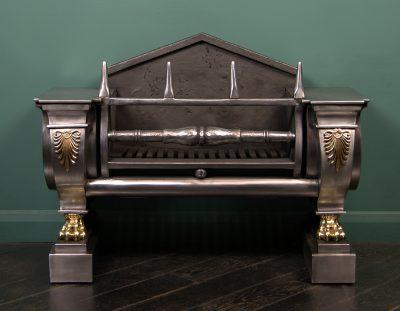 A Polished Steel Regency Sarcophagus Grate