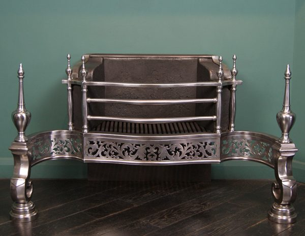 A Magnificent Bright Wrought-Iron Dog Grate